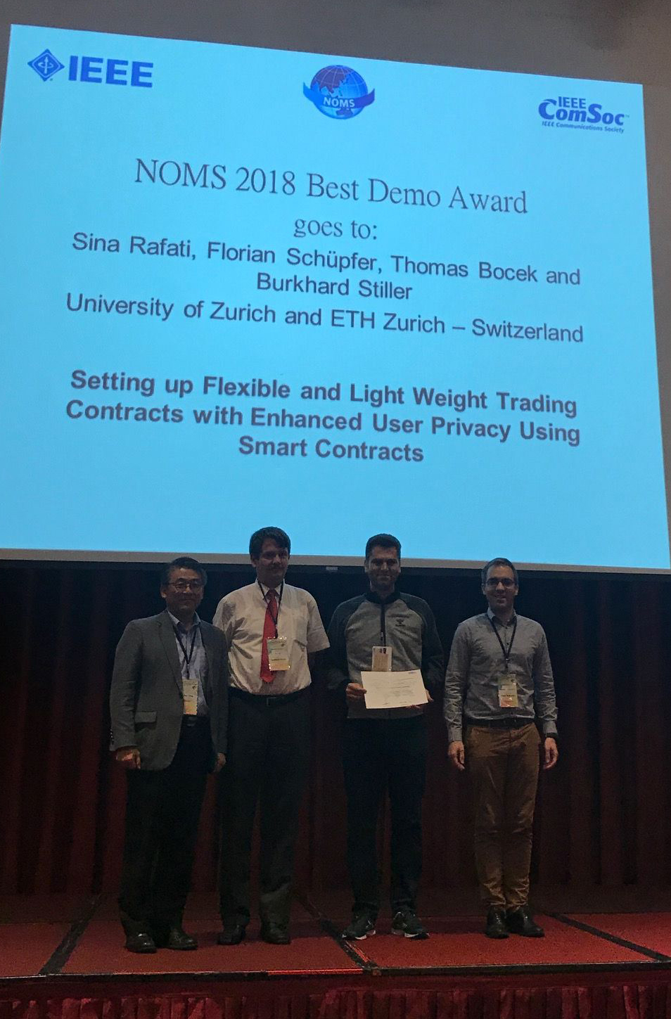 16th IFIP/IEEE NOMS 2018 Best Demo Award Team at NOMS with the Plaque Received: from the left, Prof. Dr. James Hong, Prof. Dr. Burkhard Stiller, Sina Rafati, Prof. Dr. Remi Badonnel (picture thanks to Dr. Marinos Charalambides)